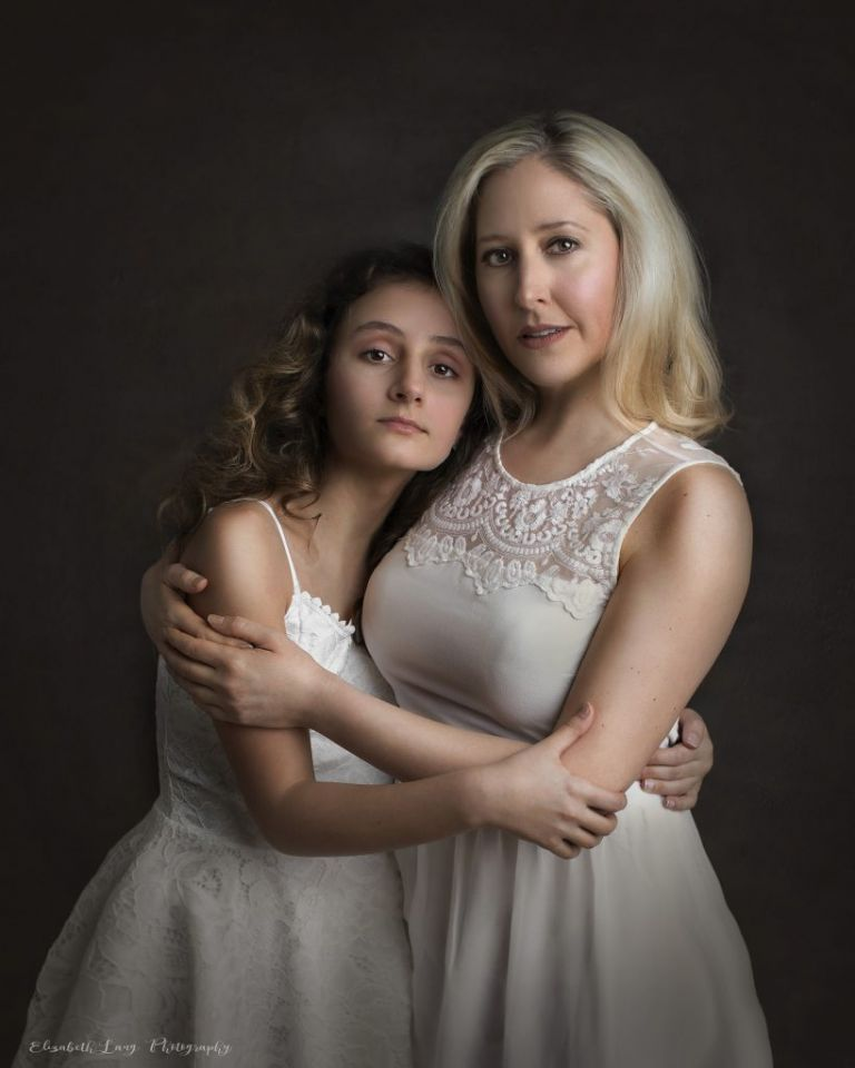 Mother and child portraits with a dark backdrop and dramatic lighting. Fine art inspired portraiture