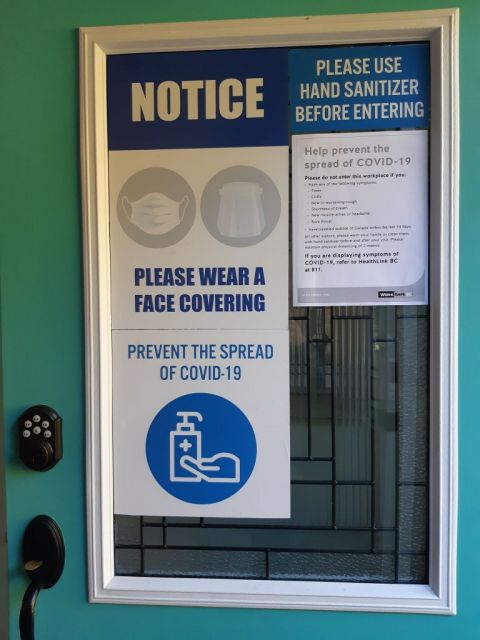 Door sign displaying Covid Safety signs